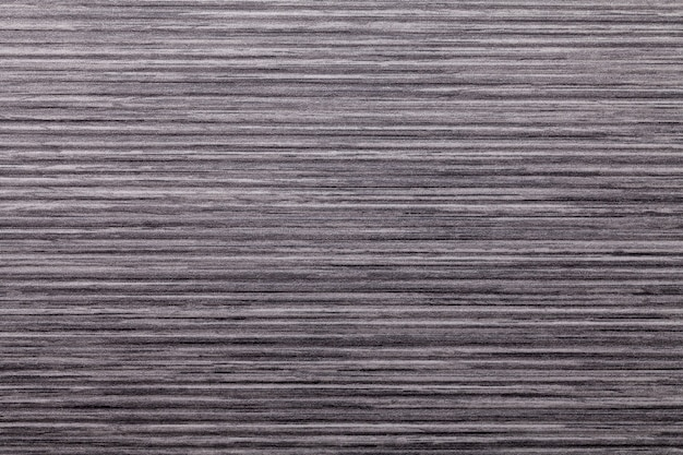 Textuur van donkerbruin oud decoratief paneel, houten patroon, macroachtergrond.