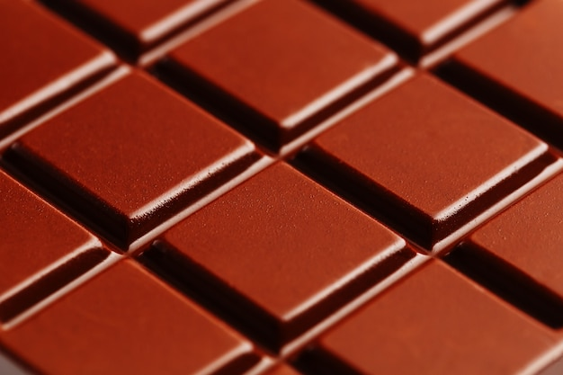 Textuur van donkere chocolade dichte omhooggaand.