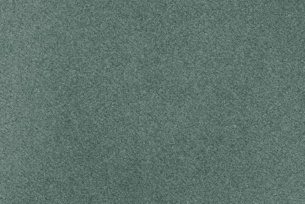 Textuur van donkergroen papier.