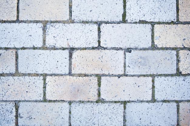 Textuur van een bakstenen muur, close-upachtergrond