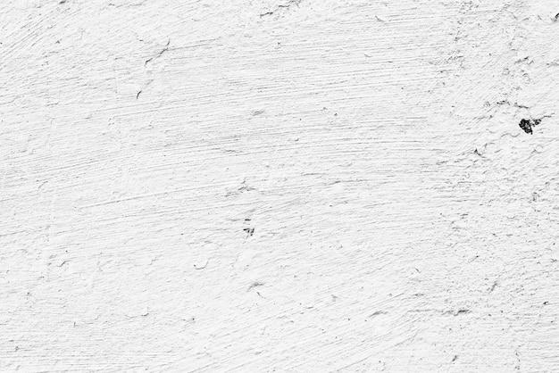 Textuur van een betonnen muur met scheuren en krassen achtergrond