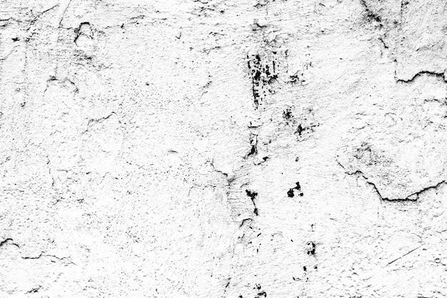 Textuur van een betonnen muur met scheuren en krassen die als achtergrond kunnen worden gebruikt