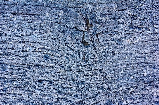 Textuur van een oude eiken plank bedekt met rijp