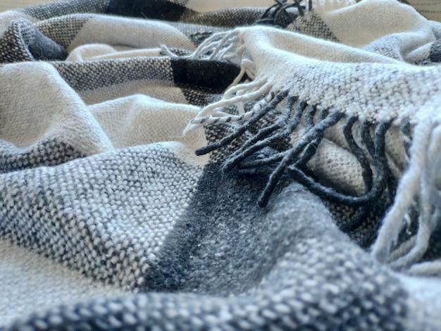 Textuur van gebreide katoenen wafelstof, kledingachtergrond met rimpels en vouwen