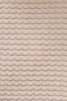 Textuur van gebreide wollen stof voor behang en een abstracte achtergrond