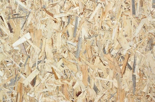 Textuur van gele houten osb-plaat dichte omhooggaand