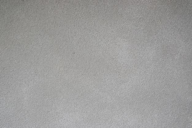 Textuur van grijze betonnen muur. achtergrond van interieur design tapijten