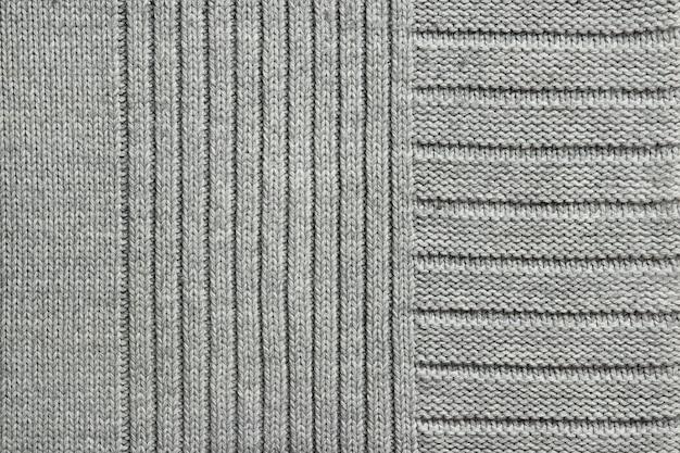 Textuur van grijze gebreide stof, close-up, hoogste mening