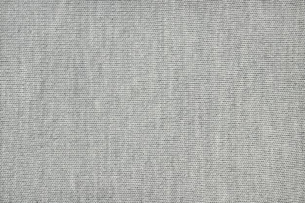 Textuur van grijze gebreide stof