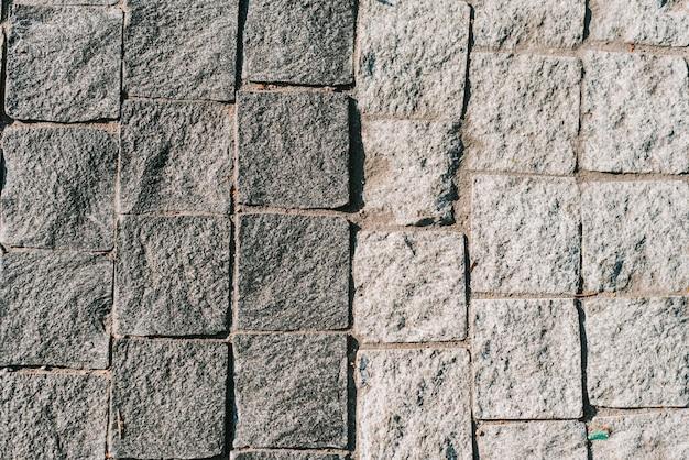 Textuur van grijze steenstraatstenen