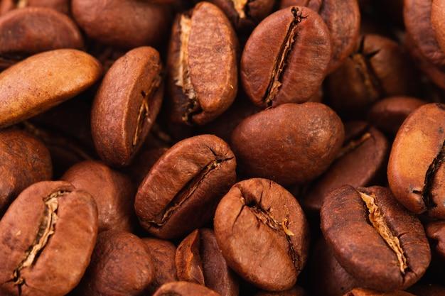 Textuur van het geroosterde close-up van koffiebonen