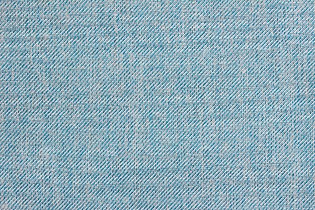 Textuur van het klassieke blauwe textielmateriaal van de stoffendoek