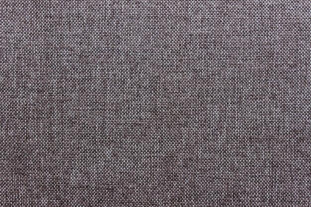Textuur van het klassieke bruine textielmateriaal van de stoffendoek