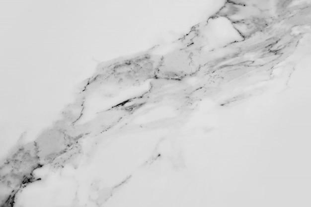 Textuur van het zwart-witte marmer.