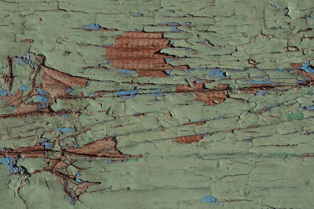 Textuur van hout geschilderd groen bord met scheuren en krassen
