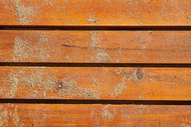 Textuur van houten planken met zand