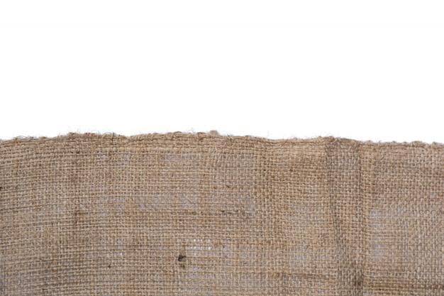Textuur van jutecanvas op witte achtergrond wordt geïsoleerd die