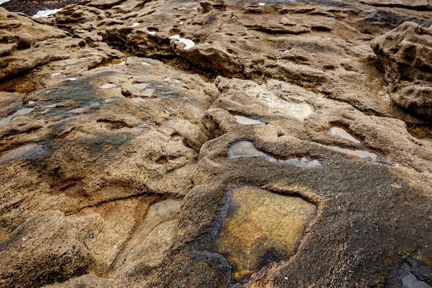 Textuur van kust oude steen. rots behang.