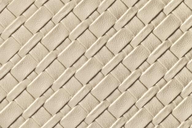 Textuur van licht beige en zandleer achtergrond met rieten patroon