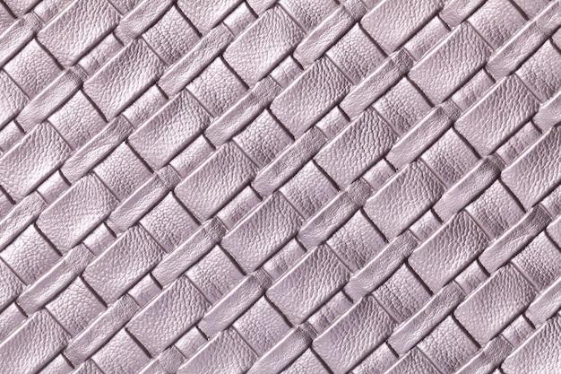 Textuur van lichtpaarse leerachtergrond met rieten patroon, macro. samenvatting van violet textiel.