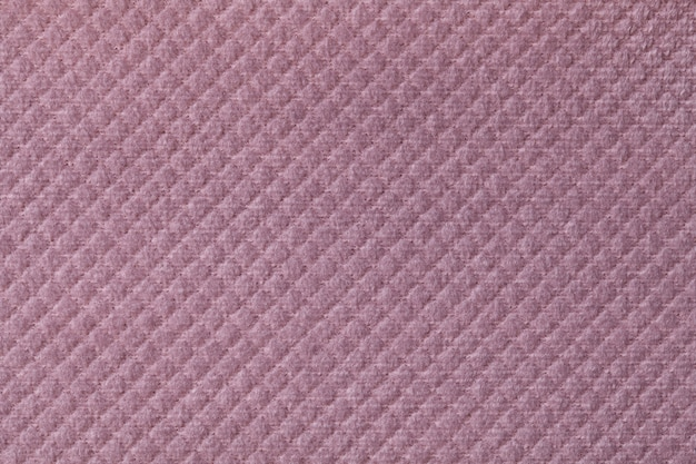 Textuur van lichtpaarse pluizige stoffenachtergrond met ruitvormig patroon, macro