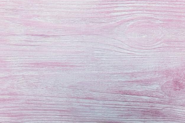 Textuur van natuurlijk hout, geschilderd in roze