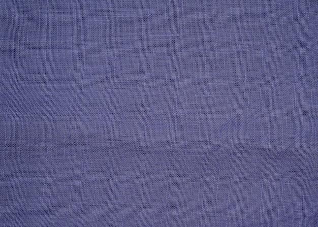 Textuur van natuurlijke blauwe of violette stof of doek. stoffentextuur van natuurlijk katoen of linnen textielmateriaal.