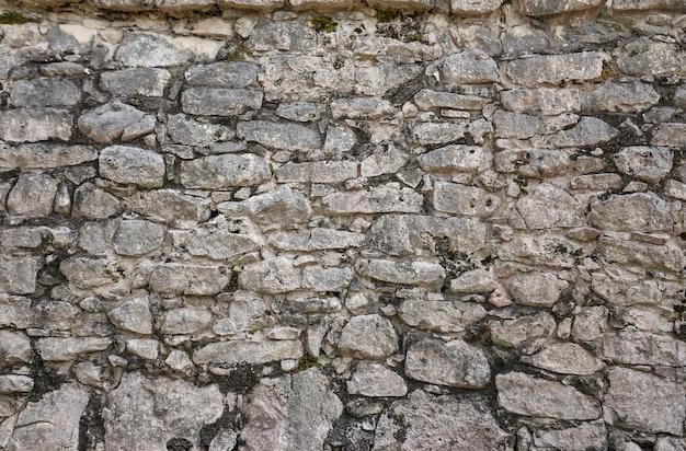 Textuur van natuurstenen die een muur vormen.