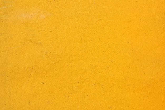 Textuur van oranje muur met enkele krasjes