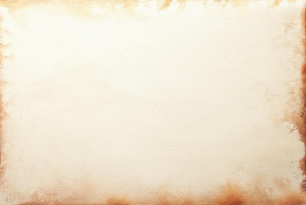 Textuur van oud beige document met koffievlek, verfrommelde achtergrond. vintage zandoppervlak. structuur van ambachtelijk karton.