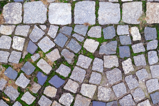 Textuur van oud cobbled-bestratingsclose-up. abstracte stenen achtergrond.