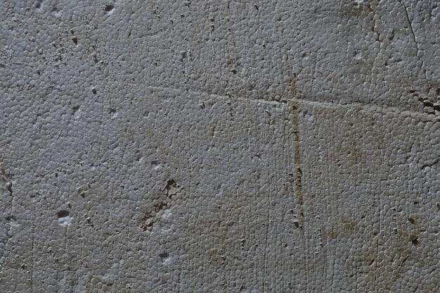 Textuur van oud vuil sjofel schuim.