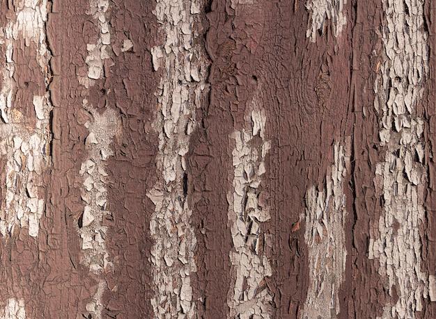 Textuur van oude bruine houten omheining met gepelde verf