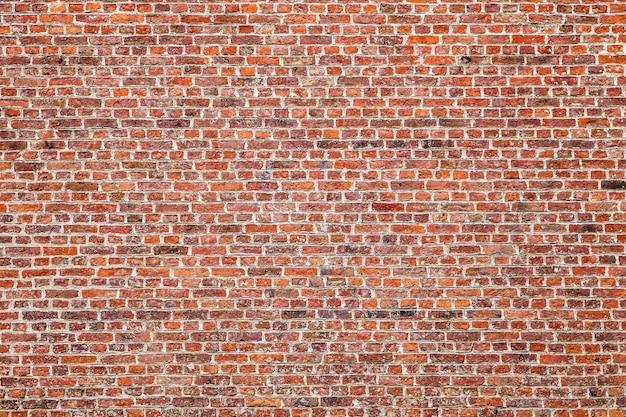 Textuur van oude donkere bruine blokken, rode bakstenen muur.