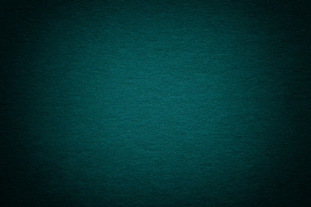 Textuur van oude donkere turkooise document achtergrond, close-up. structuur van dicht diep blauwachtig karton.