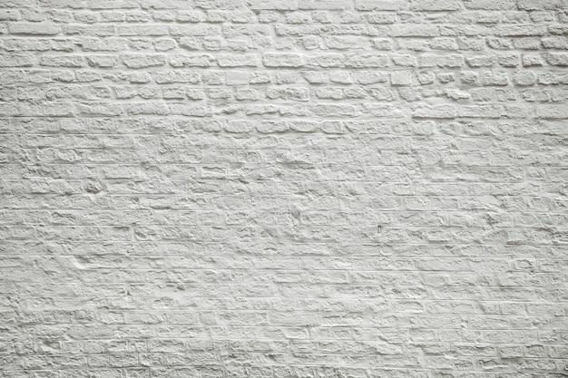 Textuur van oude donkere witte blokken, bakstenen muur.