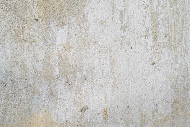 Textuur van oude grijze betonnen muur buiten, close-up