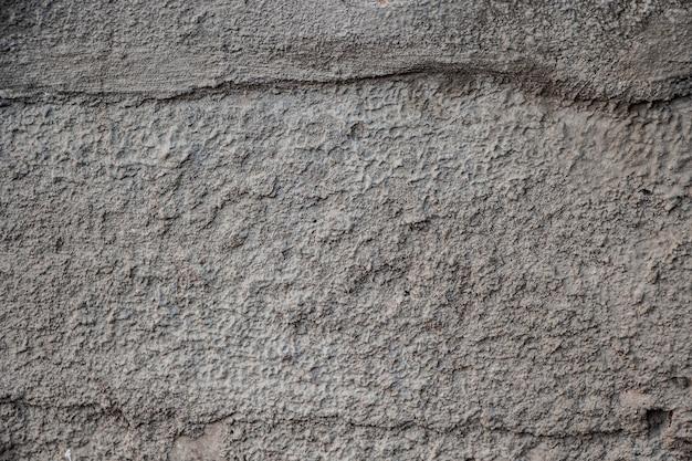 Textuur van oude grijze betonnen muur.