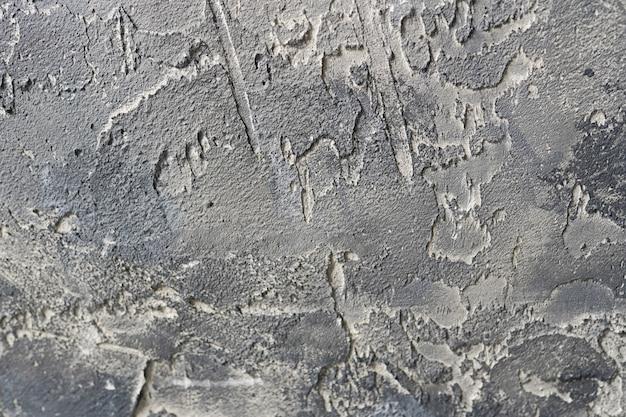 Textuur van oude grijze betonnen muur