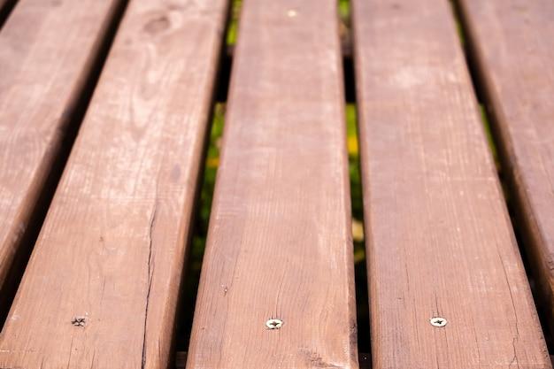 Textuur van oude houten bruin geschilderde brug vloer abstracte achtergrond.