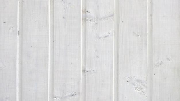 Textuur van oude houten planken met schil witte verf