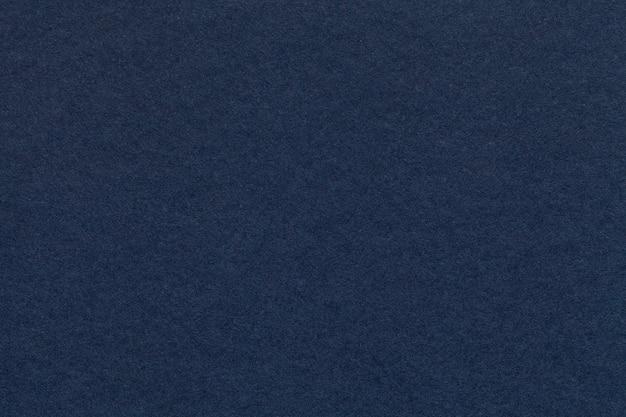 Textuur van oude marineblauwe document close-up