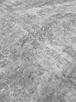 Textuur van oude vuile grijze betonnen muur voor achtergrond