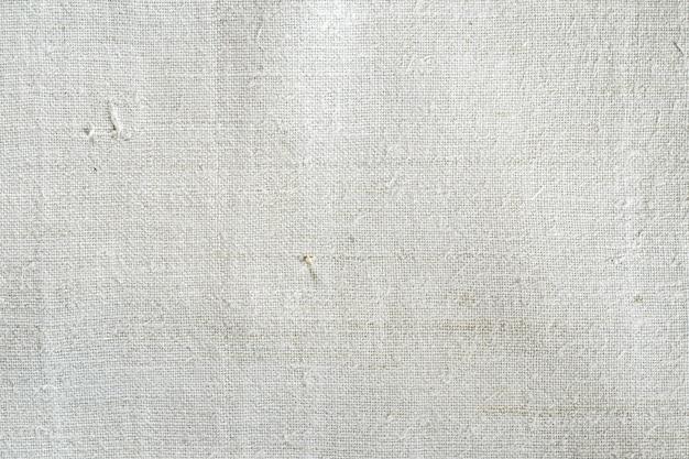 Textuur van oude zelfgesponnen hennepstof. ruw textiel. achtergrond