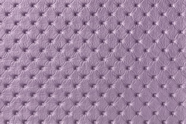 Textuur van paarse lederen stof achtergrond met capitone patroon, macro. violet textiel in chesterfield-stijl.