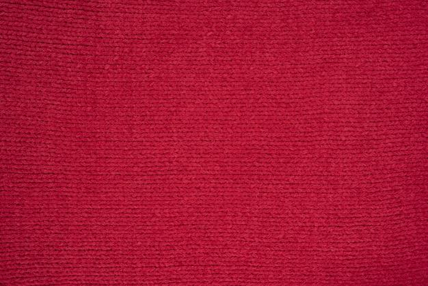 Textuur van rode gebreide stof.