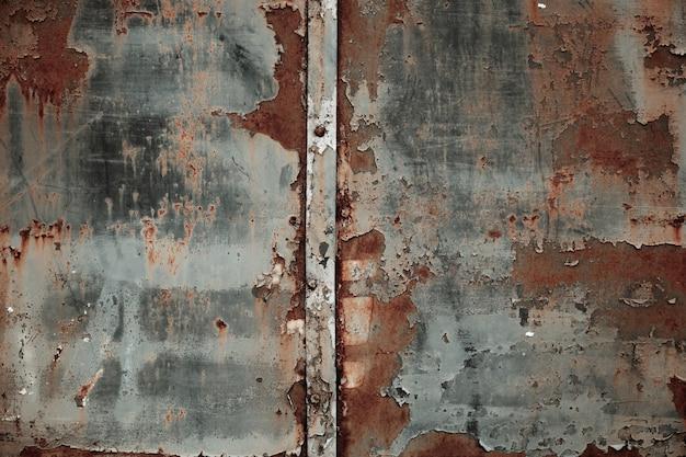 Textuur van roestig metaal met de achtergrond van de schilverf