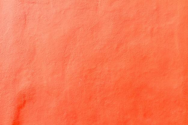 Textuur van rood geschilderde verweerde betonnen muur achtergrond