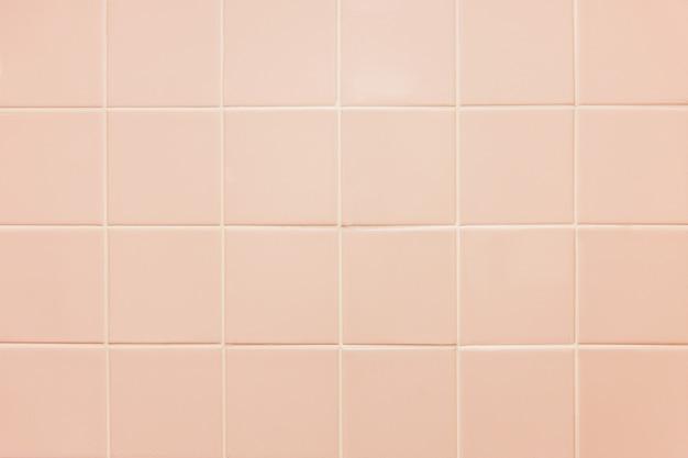 Textuur van roze tegel. lichtroze tegelachtergrond