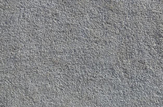 Textuur van ruwe concrete muur met in reliëf gemaakte textuur